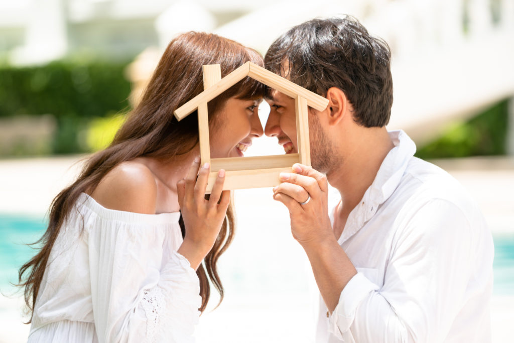 Auction-Bidding-Service-Young Couple Planning To Buy A House Concept.